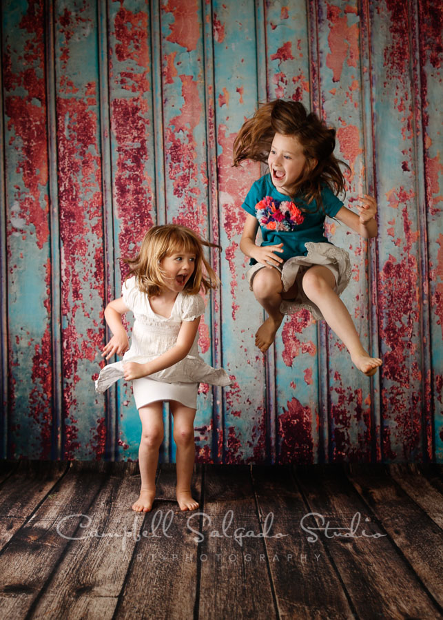 Portrait of children on Italian rust background by children's photographers at Campbell Salgado Studio in Portland, Oregon.