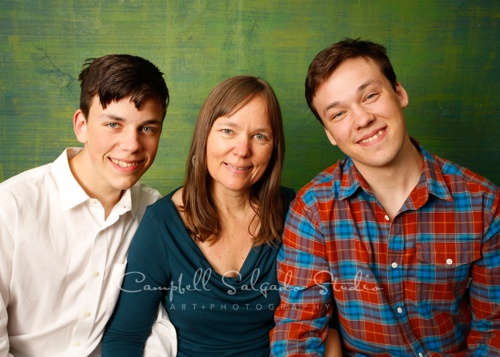 Portrait of family on blue green weave background by family photographers at Campbell Salgado Studio in Portland, Oregon.