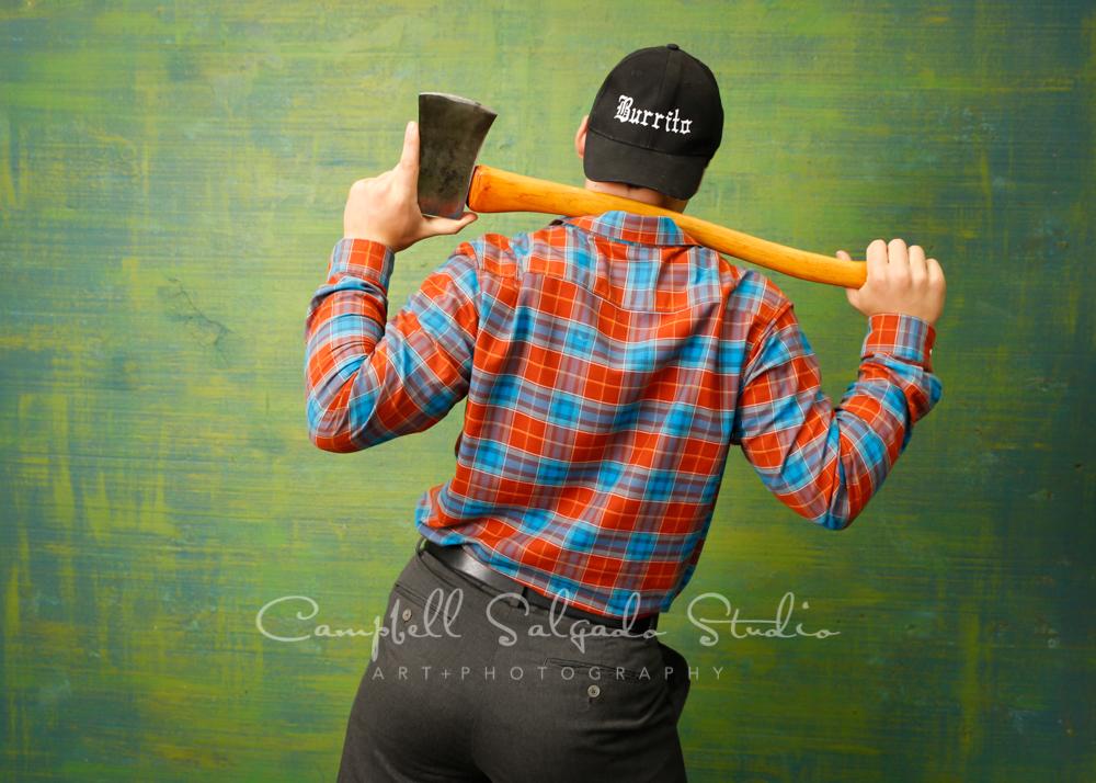 Portrait of teen on blue green weave background by teen photographers at Campbell Salgado Studio in Portland, Oregon.