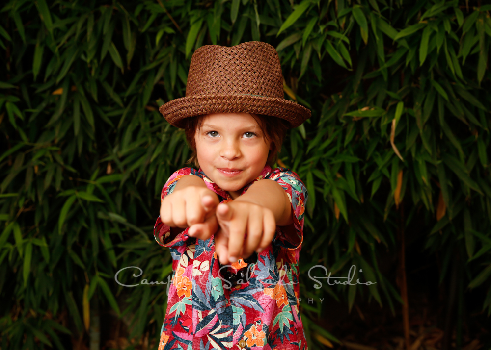 Portrait of child on bamboo background by children's photographers at Campbell Salgado Studio in Portland, Oregon.