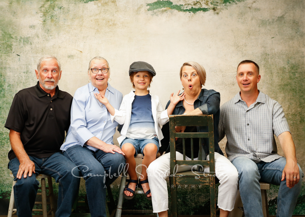 Portrait of multi generational family on abandoned concrete background by family photographers at Campbell Salgado Studio in Portland, Oregon.