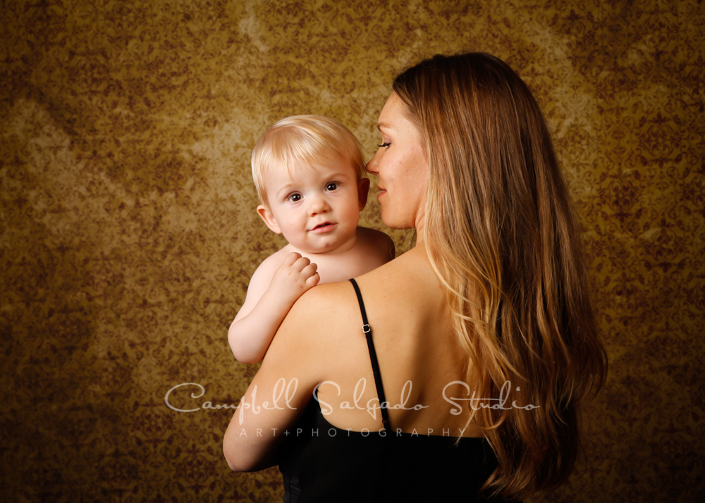Portrait of mother and son on amber light background by family photographers at Campbell Salgado Studio in Portland, Oregon.