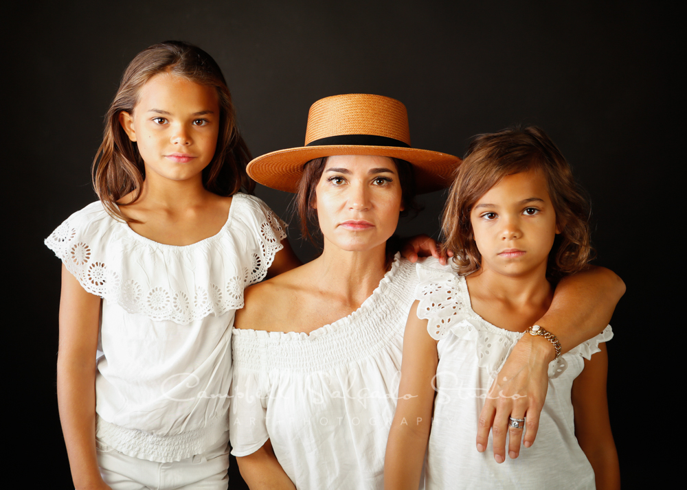 Portrait of mother and children on gray background by family photographers at Campbell Salgado Studio in Portland, Oregon.