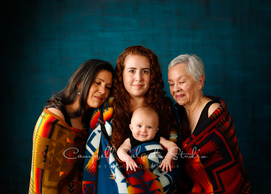 Multi generational portrait of women on deep ocean background by family photographers at Campbell Salgado Studio in Portland, Oregon.
