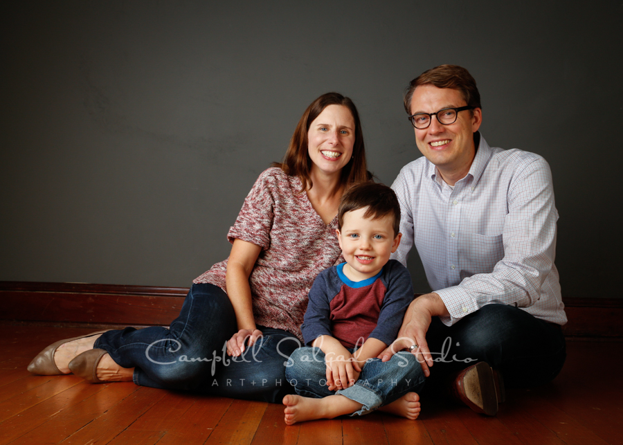 Portrait of family on a gray background by family photographers at Campbell Salgado Studio in Portland, Oregon.