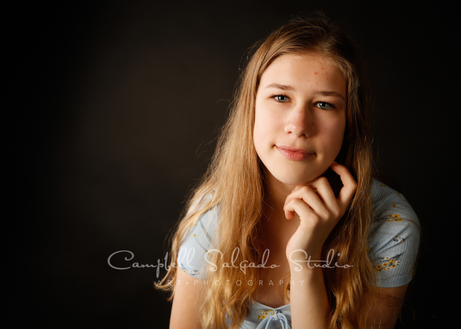 Portrait of teen on black background by family photographers at Campbell Salgado Studio in Portland, Oregon.