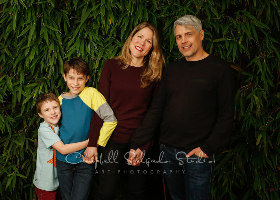 Portrait of family on bamboo background by family photographers at Campbell Salgado Studio in Portland, Oregon.