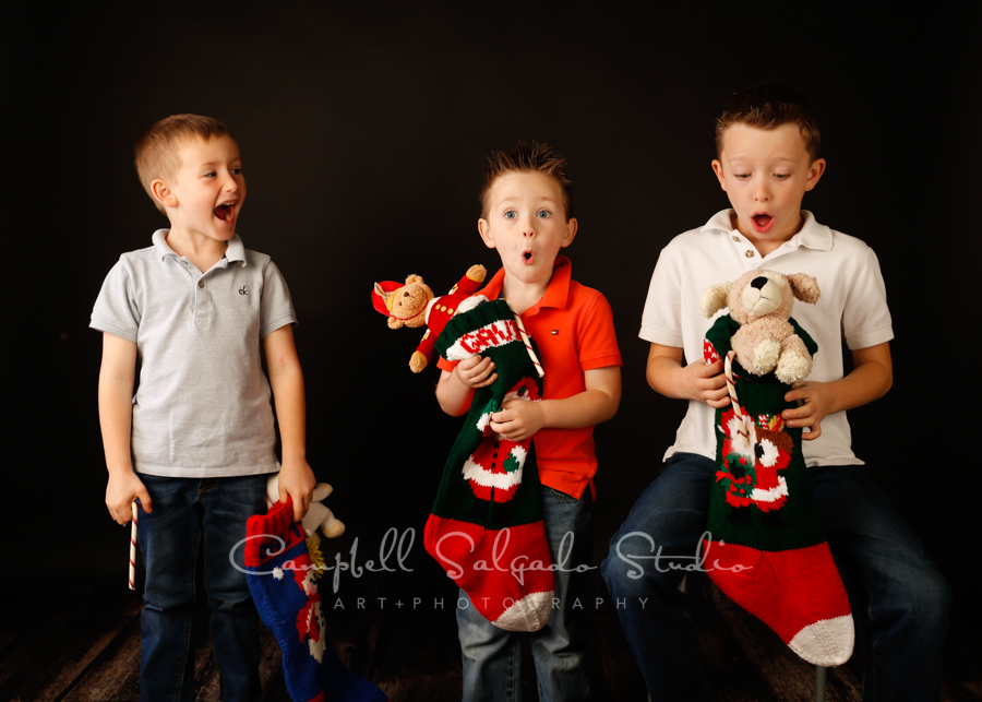 Portrait of children on black background by child photographers at Campbell Salgado Studio in Portland, Oregon.