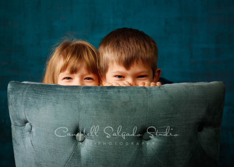 Portrait of children on deep ocean background by children's photographers at Campbell Salgado Studio in Portland, Oregon.