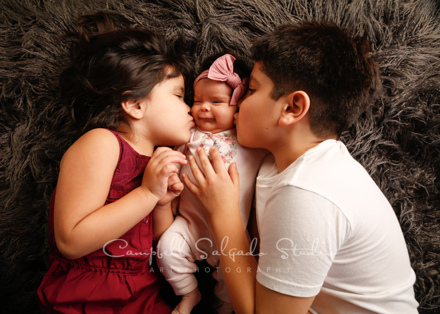 Portrait of children on blankies background by family photographers at Campbell Salgado Studio in Portland, Oregon.