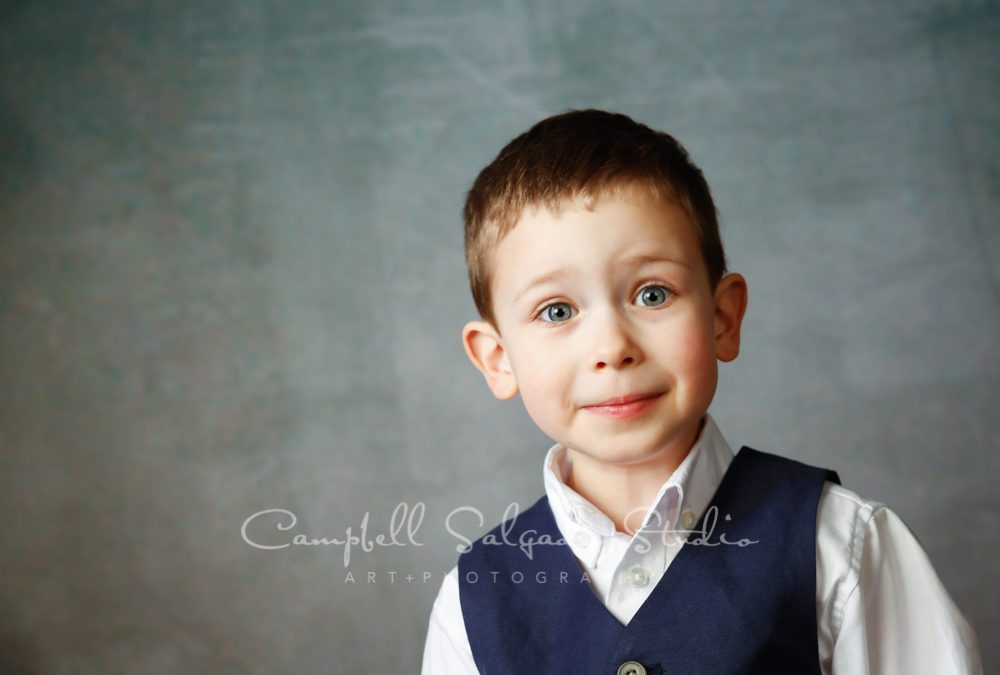 Portrait of child on On Ice background by child photographers at Campbell Salgado Studio in Portland, Oregon.