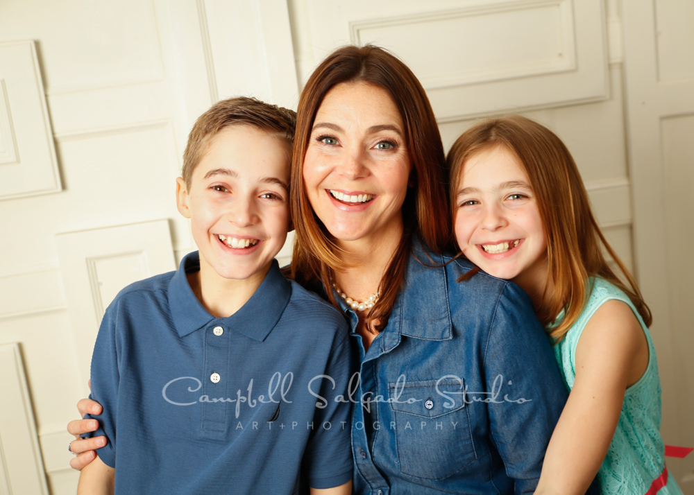 Portrait of mother and children on cream doors background by family photographers at Campbell Salgado Studio in Portland, Oregon.