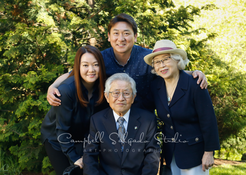 Portrait of multi-generational family on outdoor background by family photographers at Campbell Salgado Studio in Portland, Oregon.