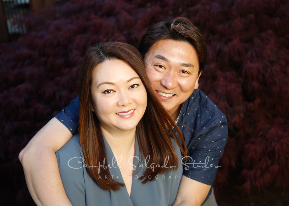 Portrait of couple on outdoor background by couples photographers at Campbell Salgado Studio in Portland, Oregon.
