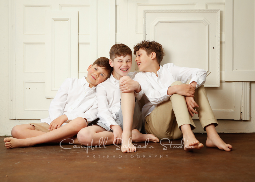 Portrait of boys on antique ivory doors background by children photographers at Campbell Salgado Studio in Portland, Oregon.