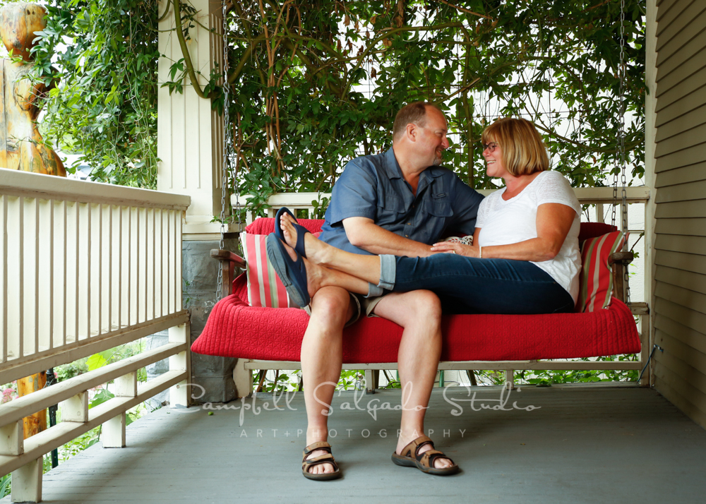 Portrait of couple on porch swing background by couples photographers at Campbell Salgado Studio in Portland, Oregon.