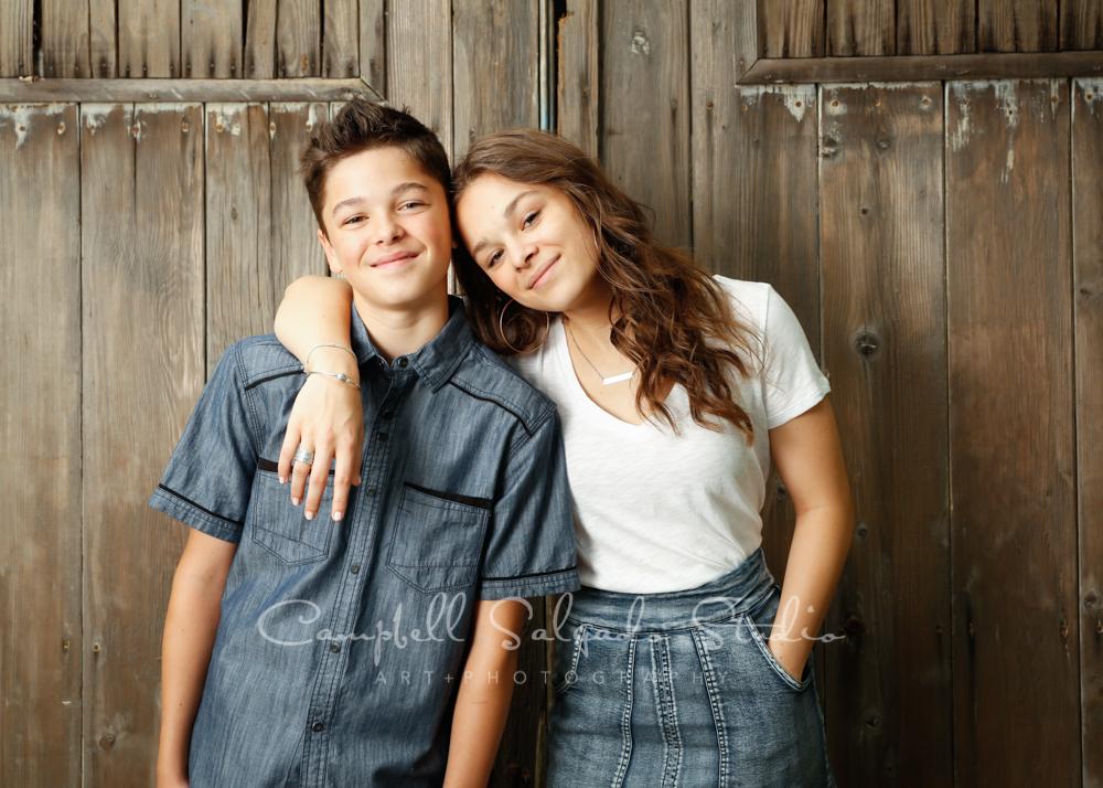Portrait of teens on barn doors background by teen photographers at Campbell Salgado Studio in Portland, Oregon.