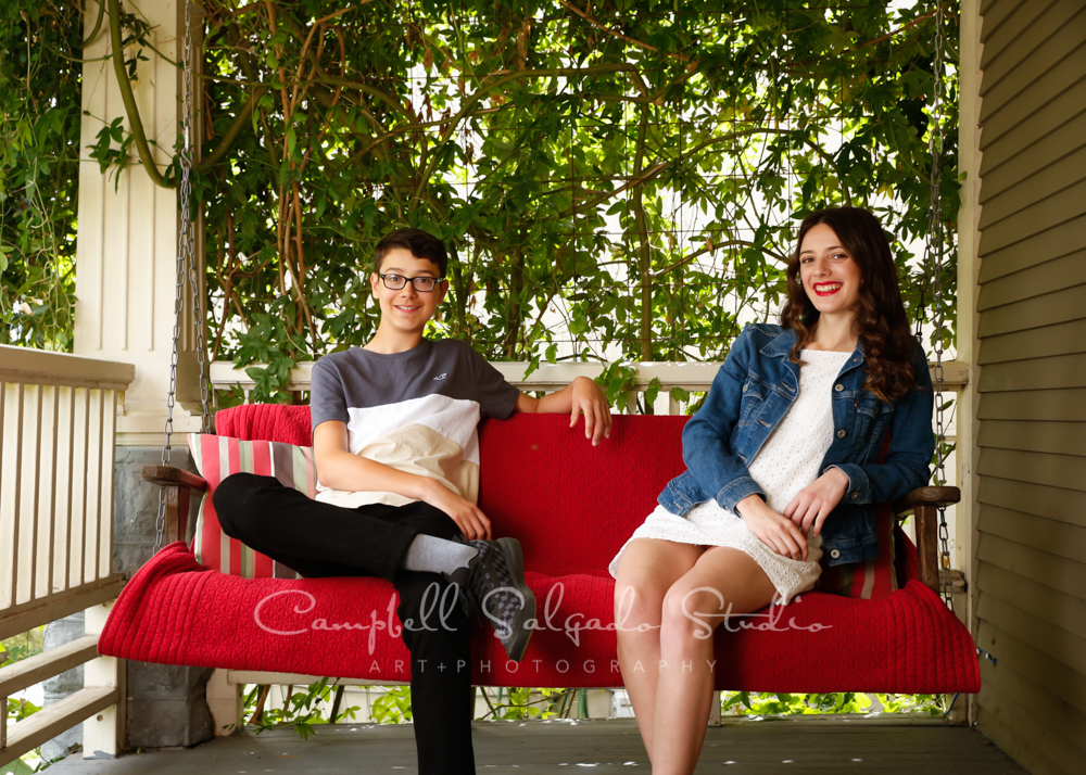 Portrait of teens on porch swing background by teen photographers at Campbell Salgado Studio in Portland, Oregon.