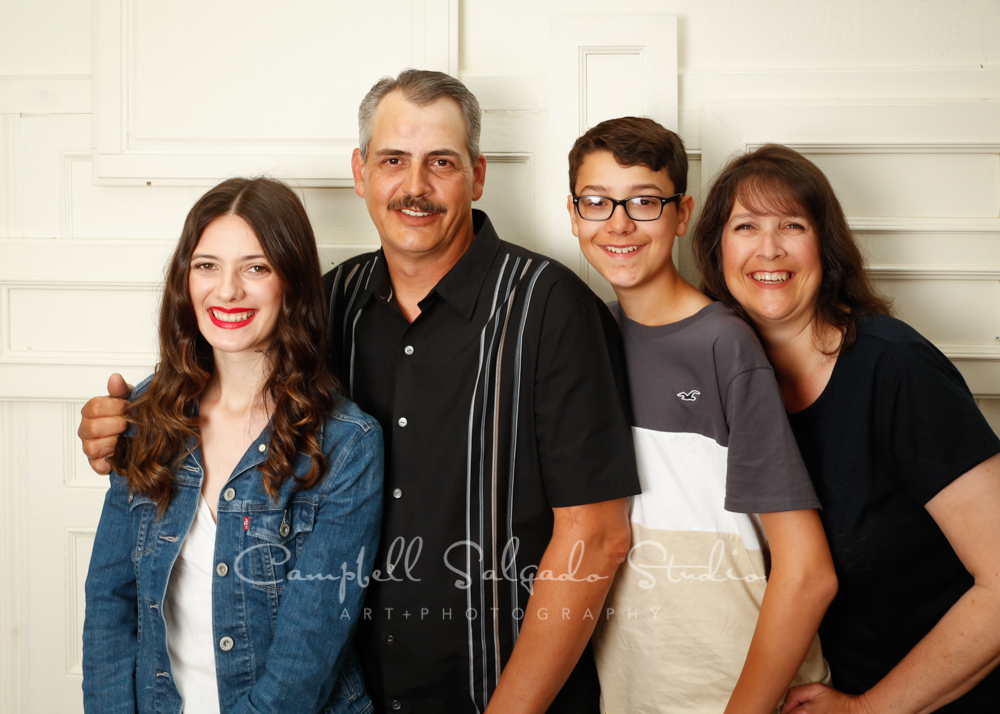Portrait of family on antique ivory doors background by family photographers at Campbell Salgado Studio in Portland, Oregon.