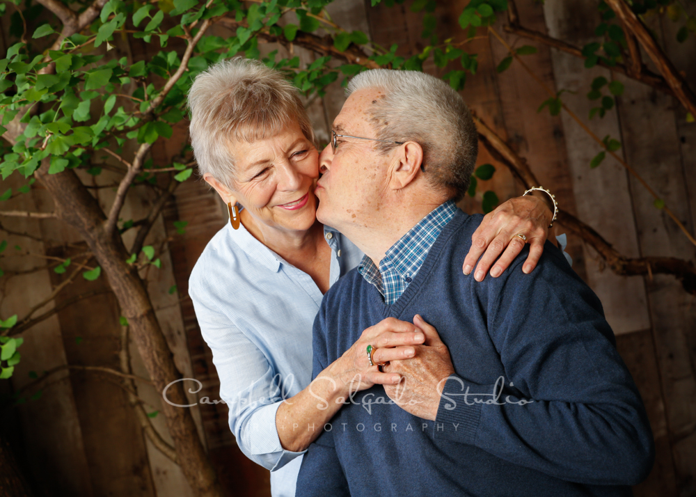 Portrait of couple on garden grove background by couples photographers at Campbell Salgado Studio in Portland, Oregon.