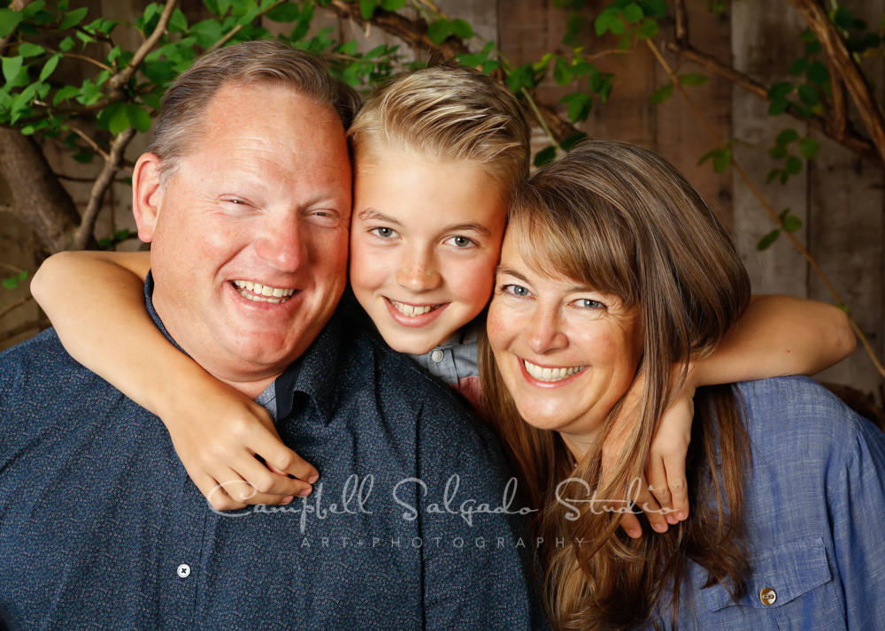 Portrait of family on garden grove background by family photographers at Campbell Salgado Studio in Portland, Oregon.