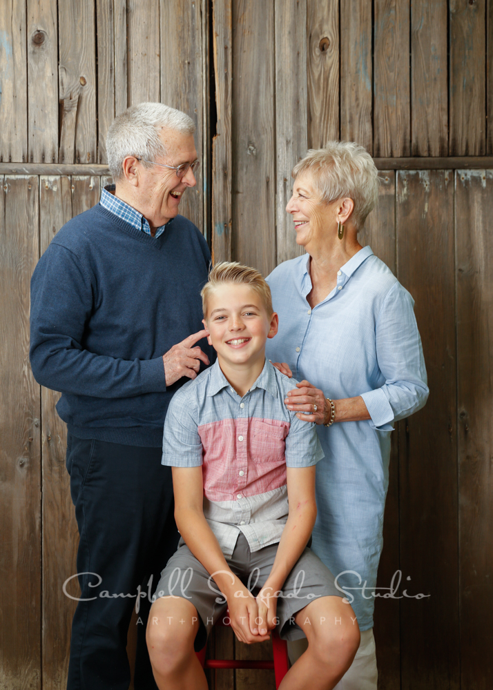 Portrait of multi generational family on barn doors background by family photographers at Campbell Salgado Studio in Portland, Oregon.