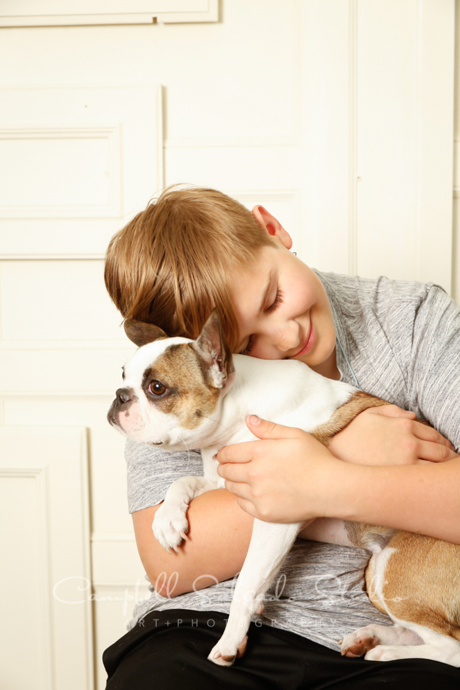 Portrait of boy and dog on antique ivory doors background by pet photographers at Campbell Salgado Studio in Portland, Oregon.