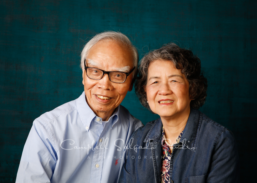 Portrait of couple on deep ocean background by couples photographers at Campbell Salgado Studio in Portland, Oregon.