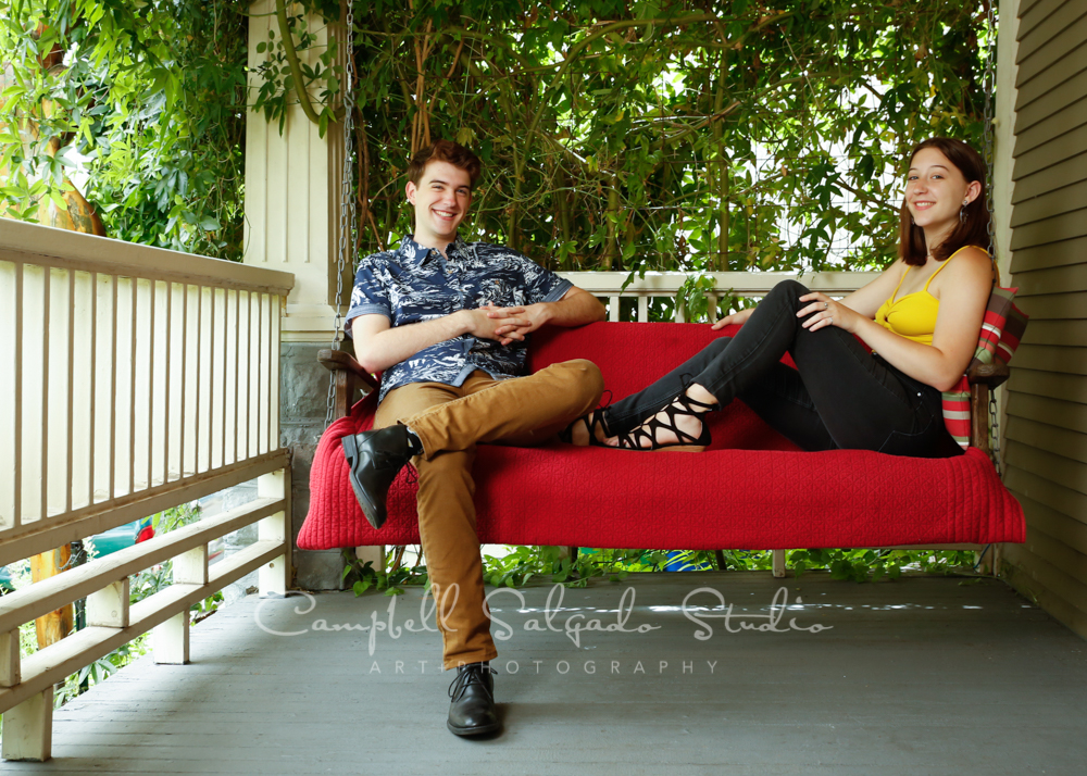Portrait of teens on porch swing background by family photographers at Campbell Salgado Studio in Portland, Oregon.