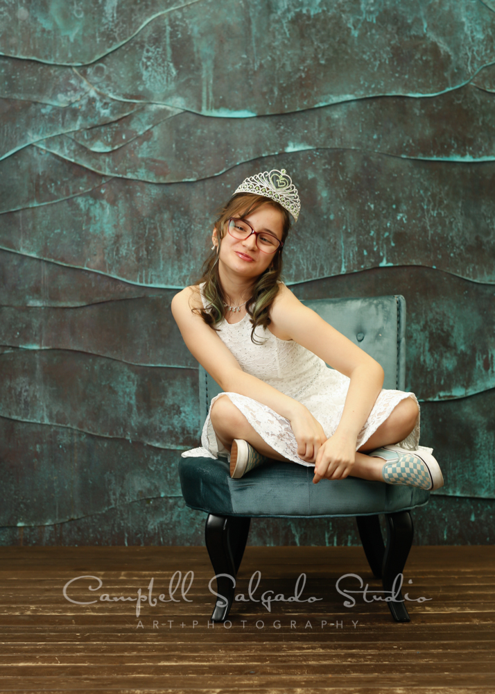 Portrait of teen on ocean weave background by teen photographers at Campbell Salgado Studio in Portland, Oregon.
