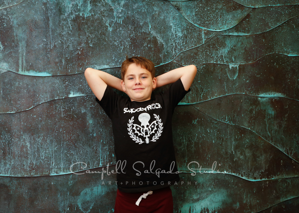 Portrait of boy on ocean weave background by child photographers at Campbell Salgado Studio in Portland, Oregon.