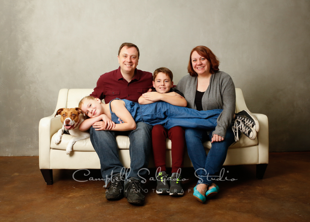 Portrait of family on modern gray background by family photographers at Campbell Salgado Studio in Portland, Oregon.