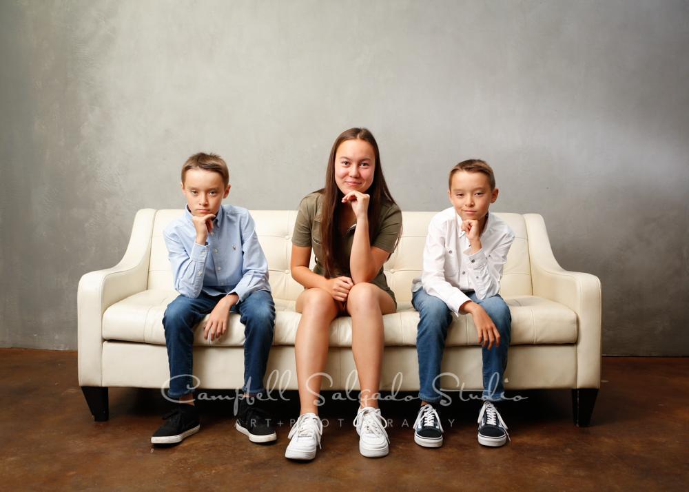 Portrait of kids on modern grey background by family photographers at Campbell Salgado Studio in Portland, Oregon.