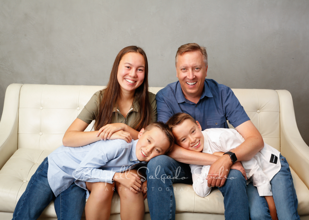 Portrait of family on modern grey background by family photographers at Campbell Salgado Studio in Portland, Oregon.