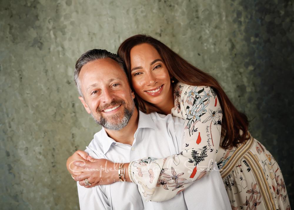 Portrait of couple on rain dance background by couple photographers at Campbell Salgado Studio in Portland, Oregon.