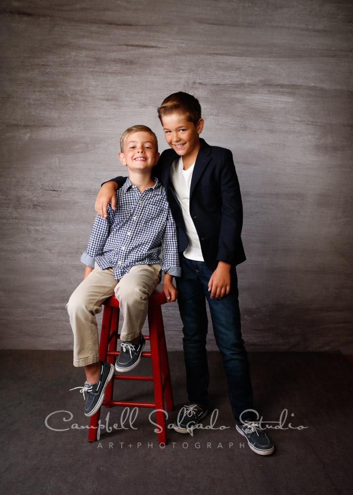Portrait of boys on graphite background by children's photographers at Campbell Salgado Studio in Portland, Oregon.