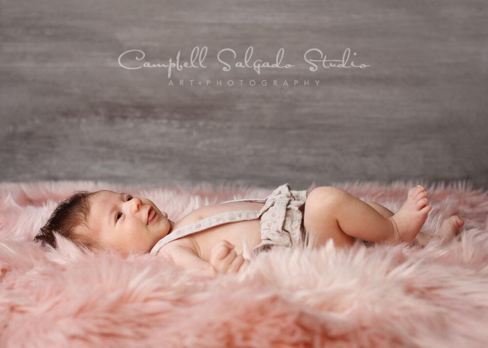 Portrait of newborn on graphite background by newborn photographers at Campbell Salgado Studio in Portland, Oregon.