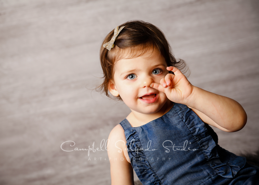 Portrait of toddler on graphite background by child photographers at Campbell Salgado Studio in Portland, Oregon.