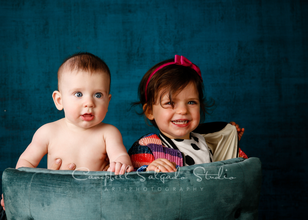Portrait of children on deep ocean background by child photographers at Campbell Salgado Studio in Portland, Oregon.