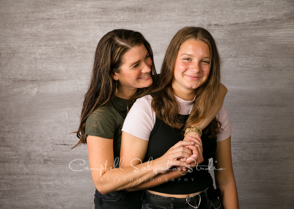 Portrait of mom and daughter on graphite background by family photographers at Campbell Salgado Studio in Portland, Oregon.