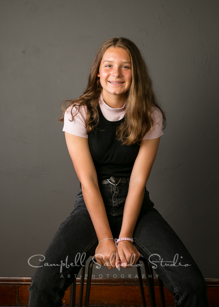 Portrait of teen on grey background by teen photographers at Campbell Salgado Studio in Portland, Oregon.