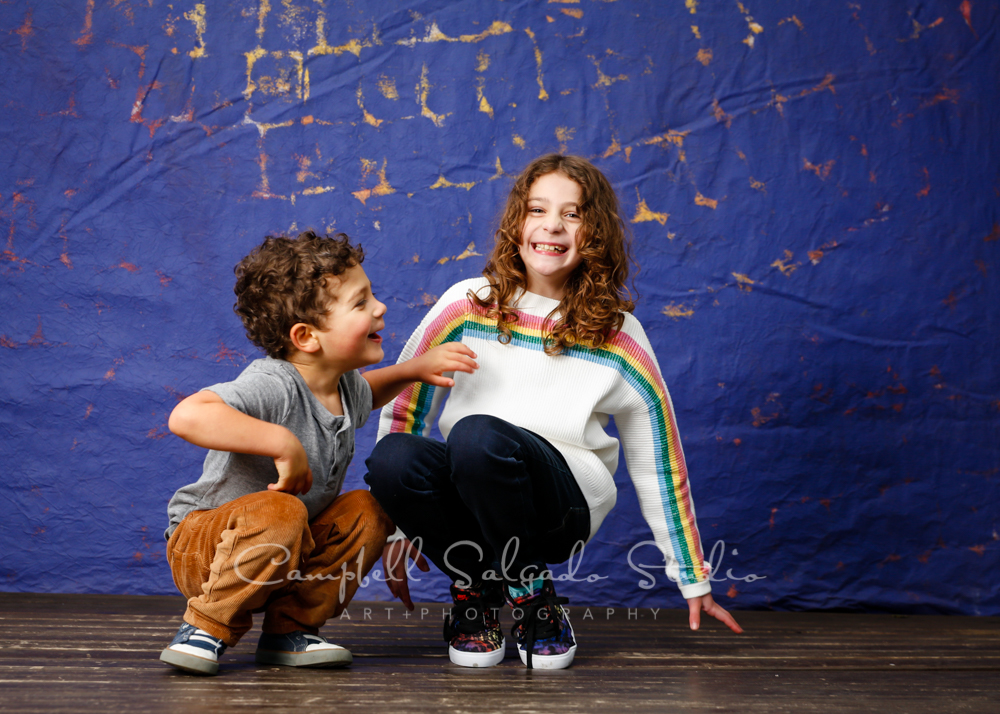 Portrait of kids on The Frida background by child photographers at Campbell Salgado Studio in Portland, Oregon.