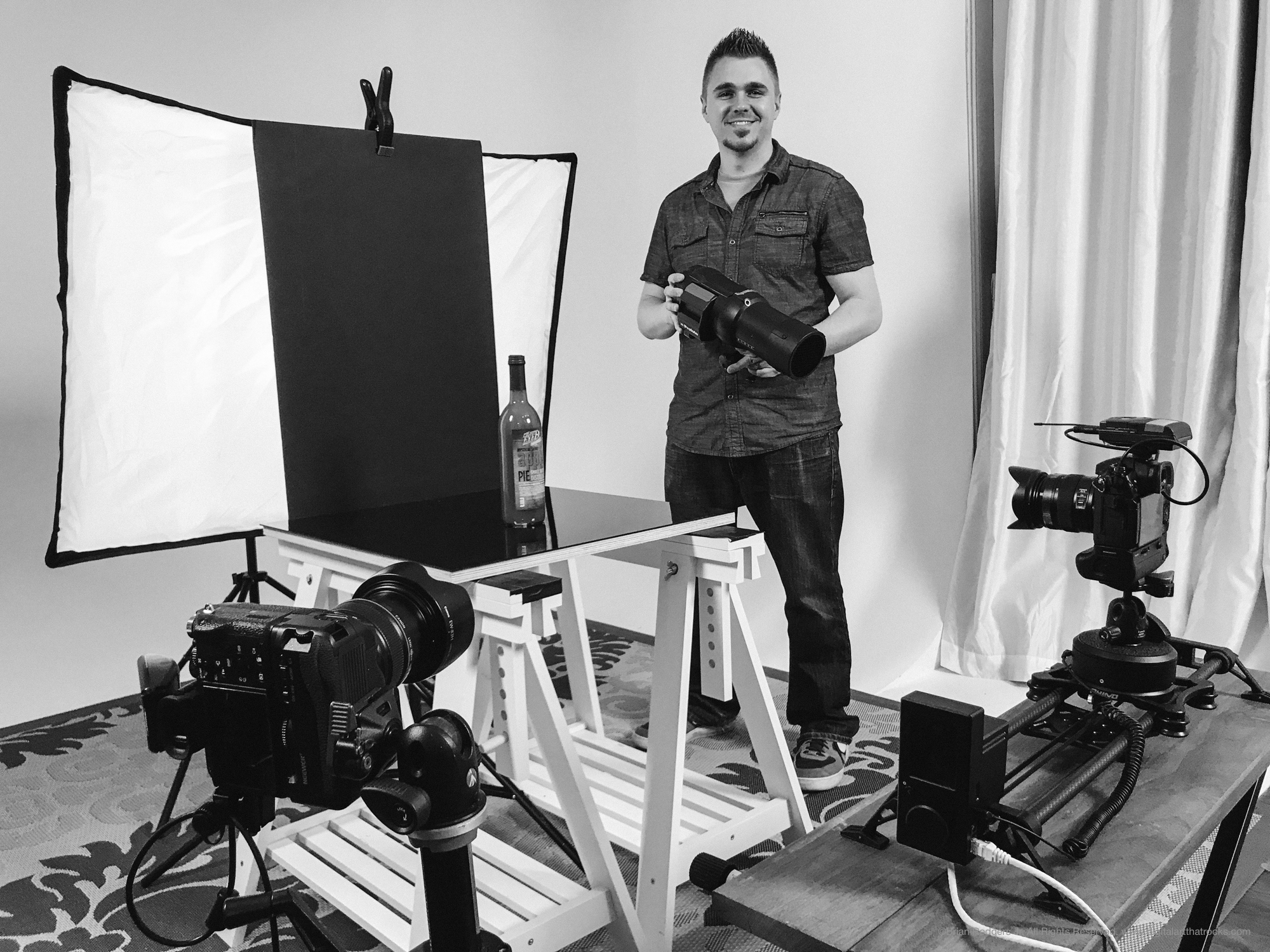 Brian Rodgers Jr. on set at Fstoppers headquarters doing a studio lighting demonstration for product photography