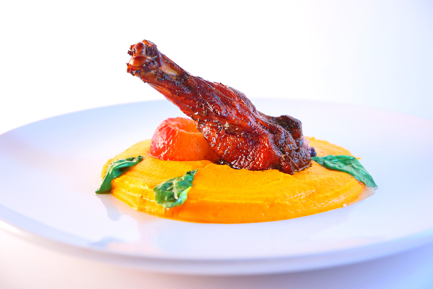 Roasted Duck over Carrot Purée with Candied Basil and Brandy Poached Apple