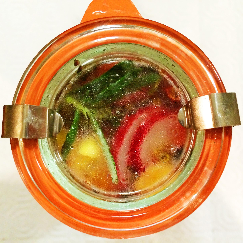 selaed jar with liquid and radishes.JPG