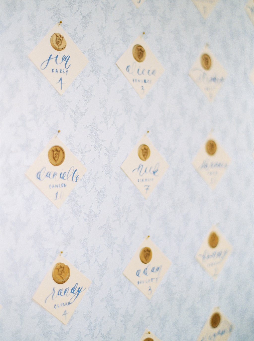 Custom Calligraphy Escort Cards with Gold Wax Seal Wedding Crest | Blush and Navy Wedding with Fuchsia, French Blue and Gold Accents | Simply Jessica Marie's Southern Wedding at Gettysvue Golf Course and Country Club in Knoxville Tennessee | Photo by Perry Vaile Photography