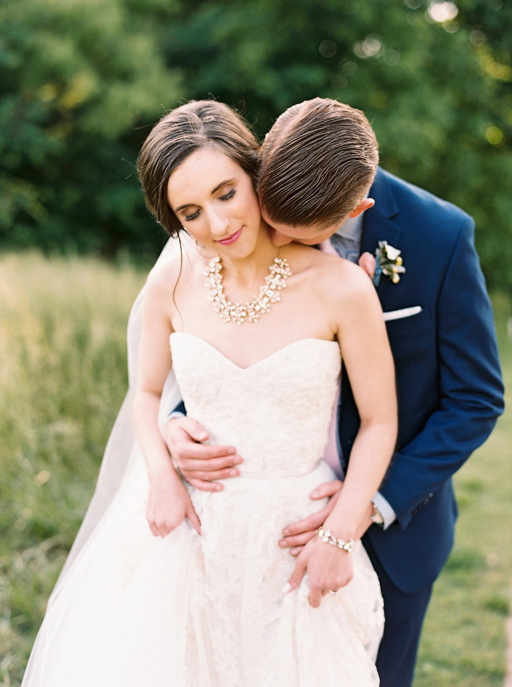 Southern Bride in Floral Lace and Tulle Reem Acra Gown with Kate Spade Crystal Arches Necklace and Low Messy Bun | Sweet Newlywed Photos after our Wedding Ceremony | Blush and Navy Wedding with Fuchsia, French Blue and Gold Accents | Simply Jessica Marie's Southern Wedding at Gettysvue Golf Course and Country Club in Knoxville Tennessee | Photo by Perry Vaile Photography