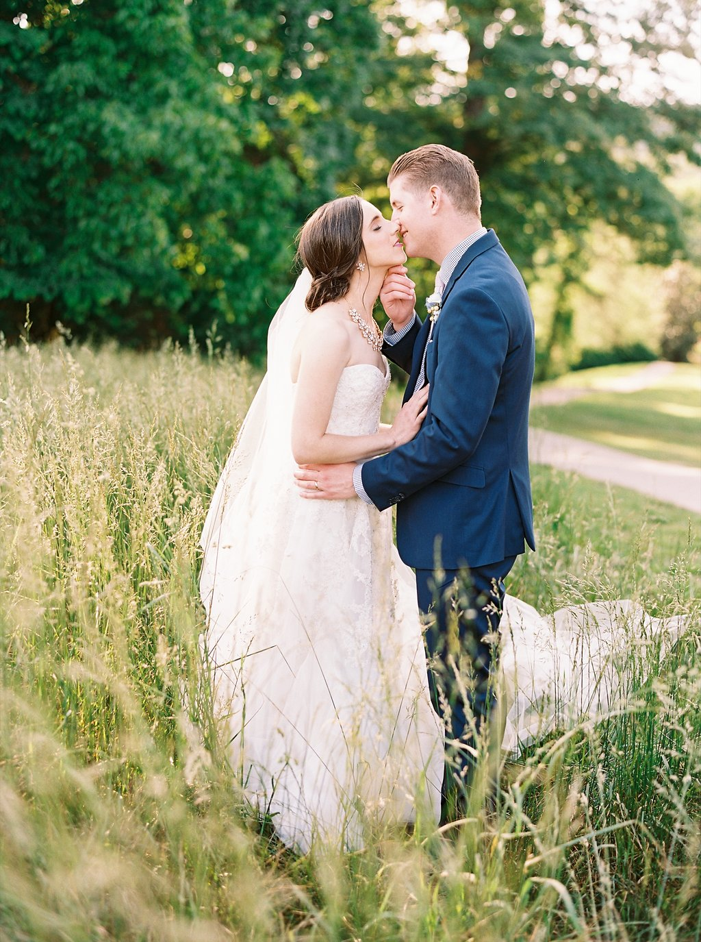 Sweet Newlywed Photos in a Field of Tall Grass after our Wedding Ceremony | Blush and Navy Wedding with Fuchsia, French Blue and Gold Accents | Simply Jessica Marie's Southern Wedding at Gettysvue Golf Course and Country Club in Knoxville Tennessee | Photo by Perry Vaile Photography
