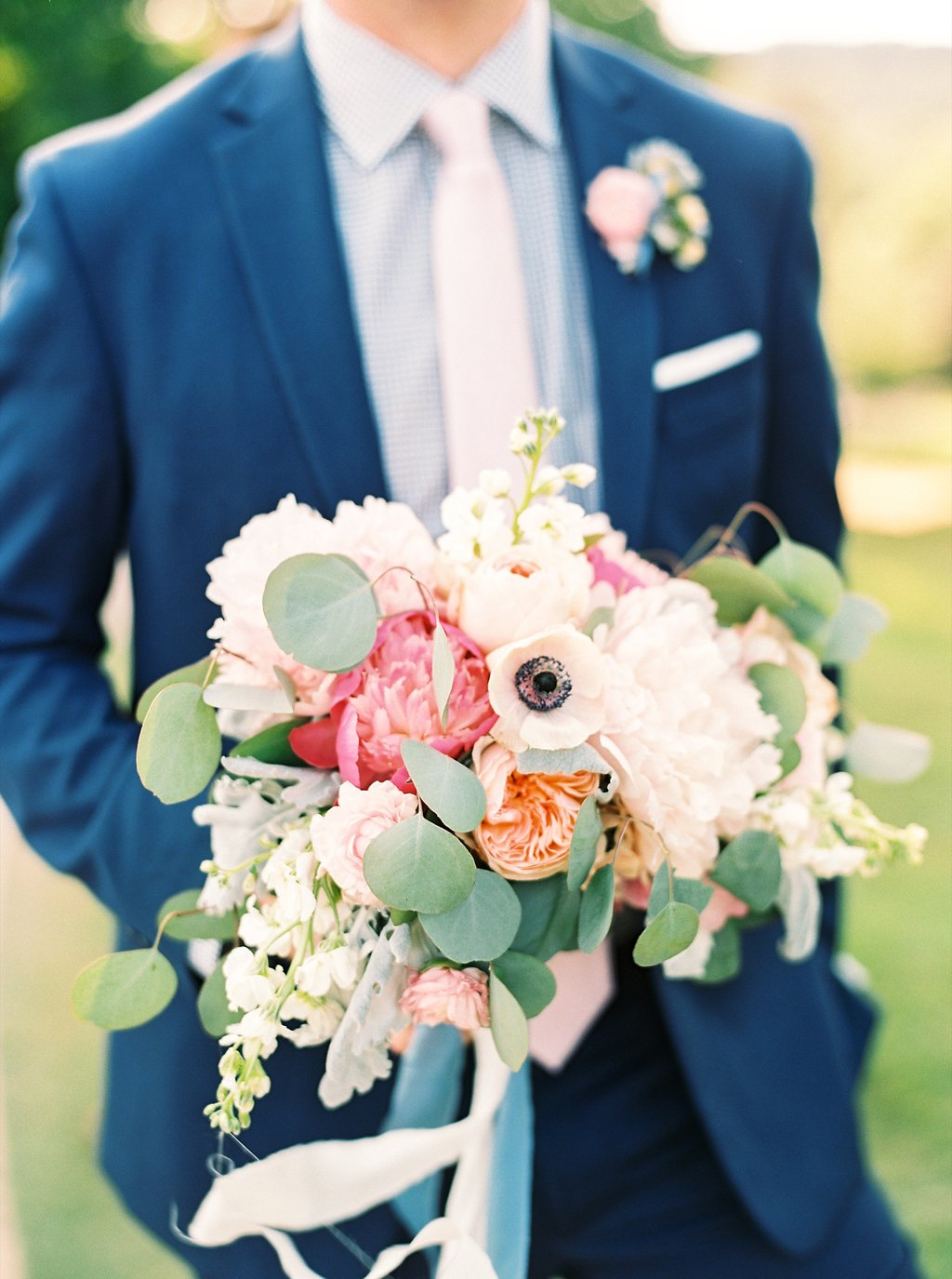 Groom Holding Blush and Fuchsia Poeny Bridal Bouquet with Peach Juliet Garden Roses and Silver Dollar Eucalyptus | Blush and Navy Wedding with Fuchsia, French Blue and Gold Accents | Simply Jessica Marie's Southern Wedding at Gettysvue Golf Course and Country Club in Knoxville Tennessee | Photo by Perry Vaile Photography