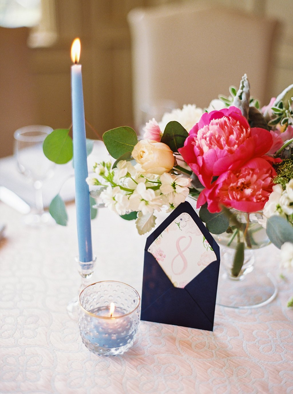 Southern Wedding Reception Design with Patterned Linens, Colorful Floral Centerpieces, Envelope Love Letter Calligraphy Table Numbers, and Sweet Blue Taper Candles | Blush and Navy Wedding with Fuchsia, French Blue and Gold Accents | Simply Jessica Marie's Southern Wedding at Gettysvue Golf Course and Country Club in Knoxville Tennessee | Photo by Perry Vaile Photography
